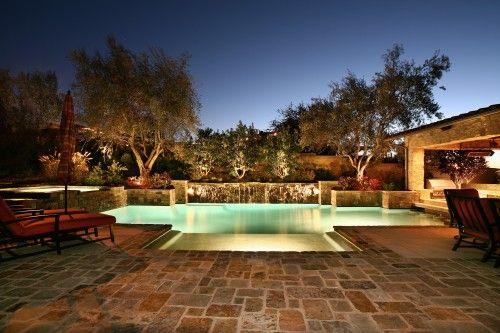 brick patio + pool. . .
