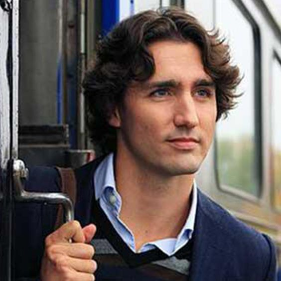 Justin Trudeau Prime Minister Of Canada Poses For A: Canadian President Justin Trudeau, A Becon Of Light In The