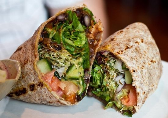Spicy black beans with chipotle avocado sauce, cilantro, tomato, lettuce, cucumber, red onion, & sprouts. yum!