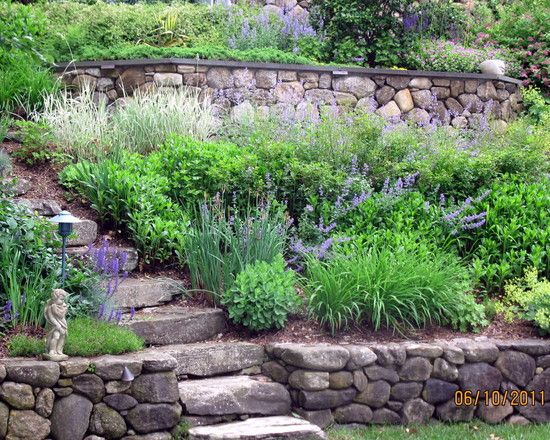 Traditional residential steep slope landscaping design for Residential landscaping ideas