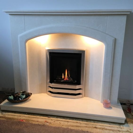 CVO Bailey High Efficiency Inset Gas Fire customer installation with stainless trim and custom surround.