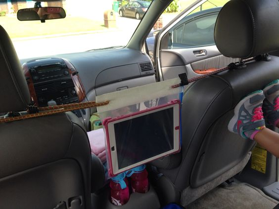 Ipad holder for car  Ziploc Bag, Duct Tape, Bungy Cords  Worked great on our road trip!
