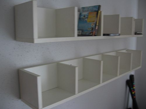 DVD storage or storage above a home office desk? Made out of rustic lumber this could be cool