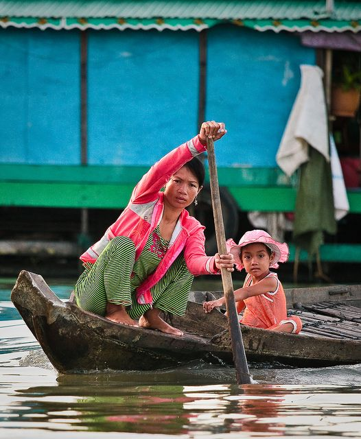 All sizes | Woman and child navigate the waterways of Kompong Phhluk, Cambodia, via Flickr.