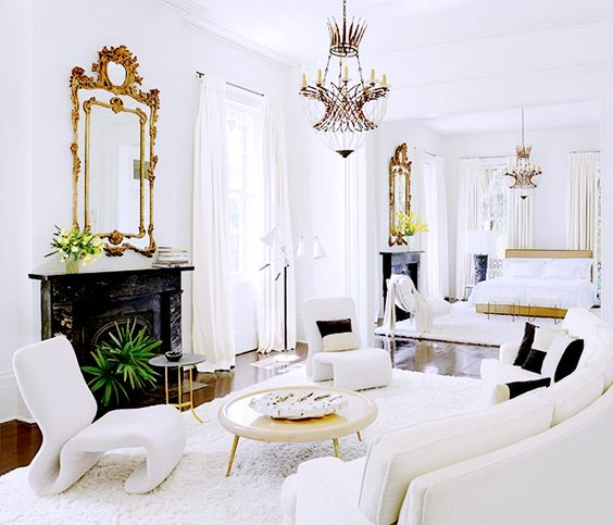 From Art to Lighting — How To Decorate Like an It Girl// All-white bedroom, gilt mirror