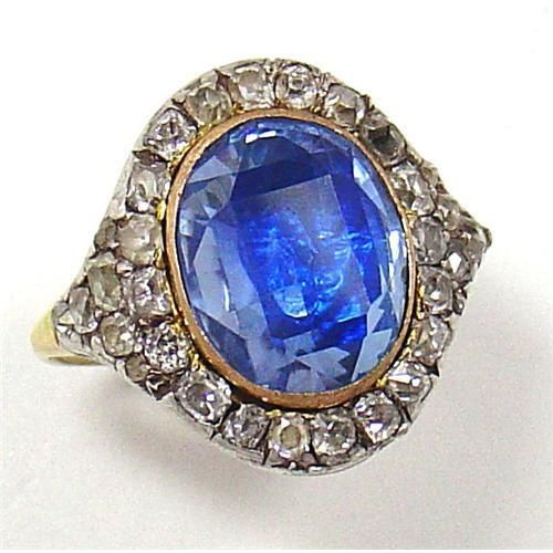 Sapphire and diamond ring, late 18th-early 19th century. 6 ct sapphire is set in a gold bezel surrounded by mixed brilliant diamonds set in silver. Like most Georgian stones, likely to be foiled.