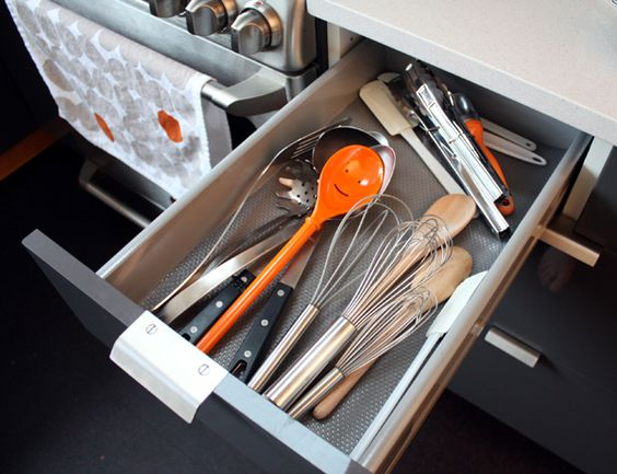 Smiley hiding amongst the other utensils