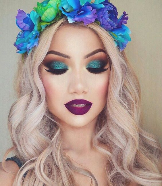 Love the way all these amazing colors are poppin'!! Blue eye shadow #makeup with burgundy lips @futurefashionstate