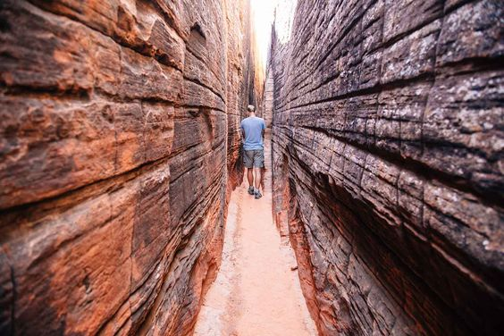 Hike to a slot canyon containing ancient petroglyphs that are thousands of years old in Snow Canyon State Park near St. George, Utah