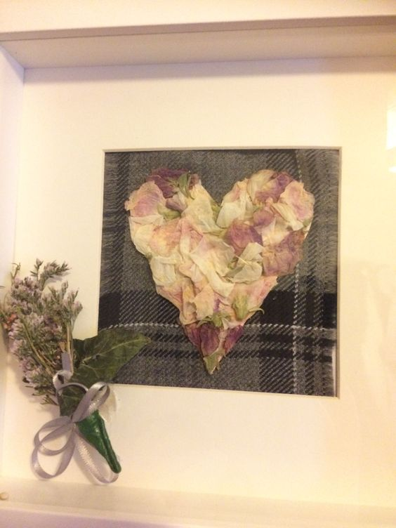 Petals from the brides bouquet, tartan from the grooms kilt and the groom's button hole made into a memorable frame.