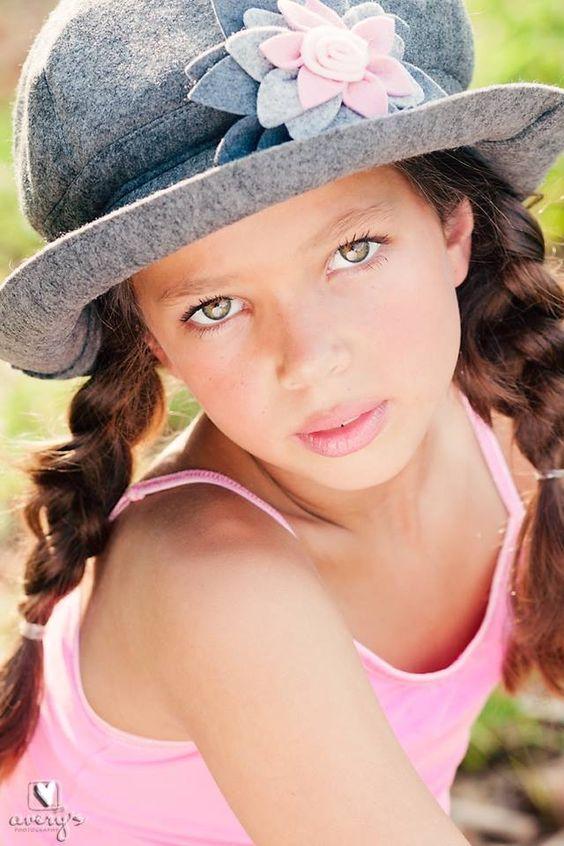braids little girl hazel eyes child model magazine hair
