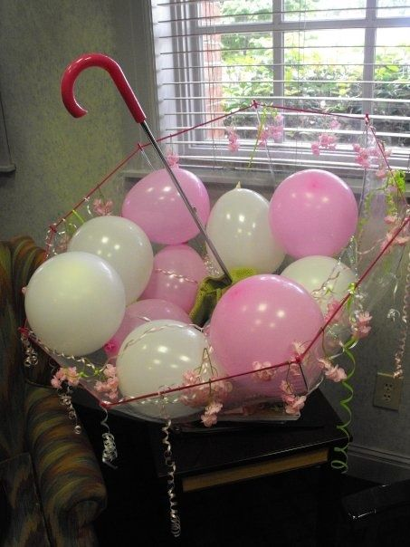 balloons in an umbrellas suspended from ceiling great baby shower ideas clear
