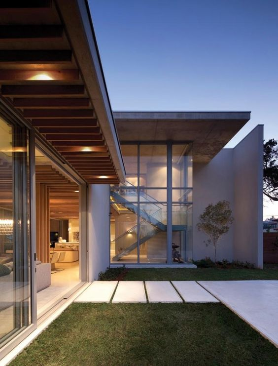 Contemporary cocoon house; retractable glass doors – interior ...