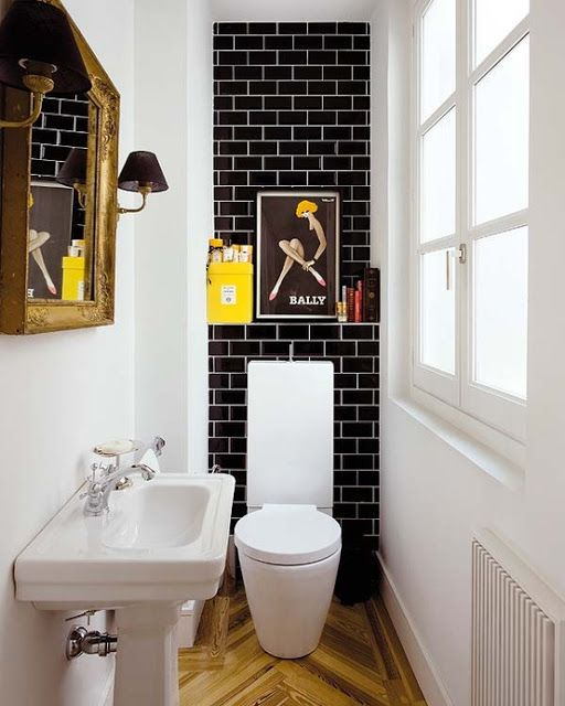 Tiny powder room with black Subway Tile and white grout. Herringbone floors. #smallspaces #powder_room