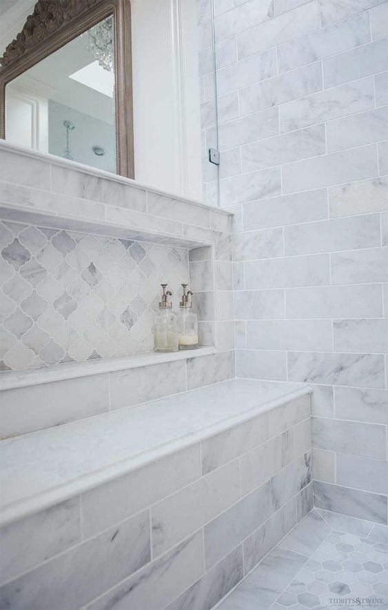 Oversized shower niche with arabesque carrara marble in French elegant master bathroom #masterbathroom