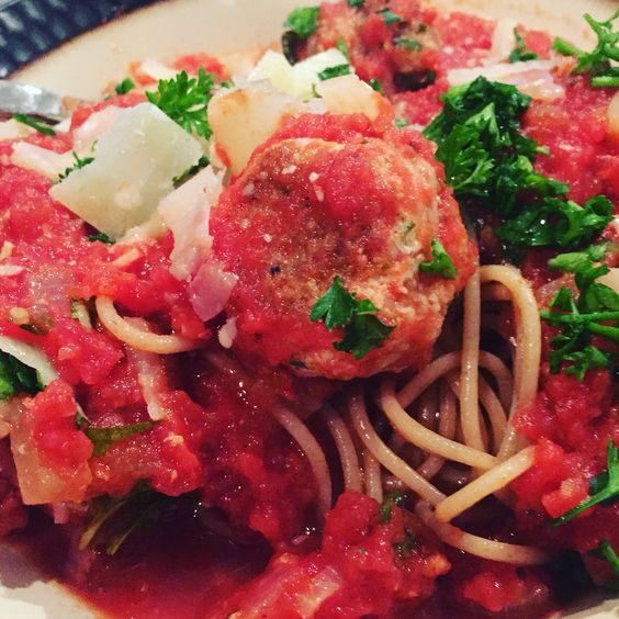 Homemade turkey meatballs, fresh marinara sauce, while wheat noodles, topped with fresh parm and parsley!