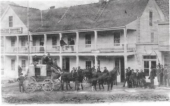 "An Idaho ""mud wagon"" arrives at Silver City's Idaho Hotel."