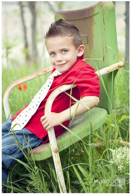 Boy in old lawn chair
