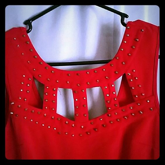 Red studded  cutout dress lg Red dress with cutouts it has a stain on the front and a small seam rip below the zipper.make me an offer love Chesley  Dresses Mini