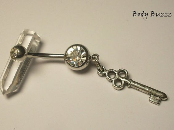 May this key open the secrets of your heart, your soul or perhaps your mind.  Pretty and unique belly button jewelry. This piercing has two gems, and a key charm. 14 gauge.  https://www.etsy.com/ca/listing/229839779/the-key-of-secrets-a-beautiful-little?ref=shop_home_active_2