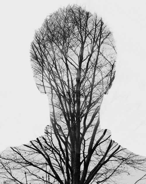 Double exposure, showing relationship between man and nature