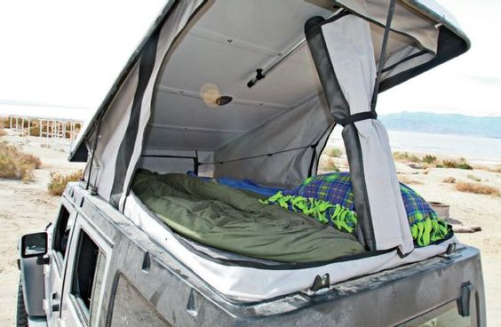 Looking to go camping in comfort ? Take a look at this 2007 Jeep Wrangler Unlimited Rubicon equipped with Ursa Minor's J30 hardtop camper conversion.