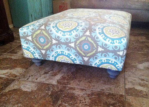 Easy pallet ottoman in 4 simple steps!   1. Screw two pallets together  2. Cover in three layers of batting.  3. Wrap fabric like a present and staple.  4. Add super cute legs from Home Depot stained gray.  5. Enjoy your super cute ottoman!