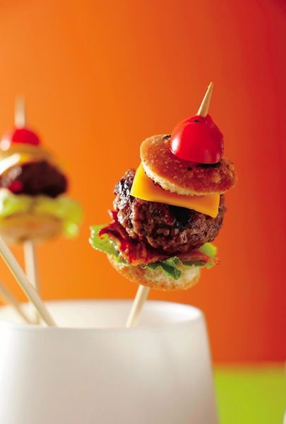 Bite-sized Burger Skewers; cut mini-buns from foccacia and use your favourite hamburger recipe to create tiny versions on skewers. Delish!