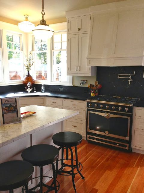 considering painting kitchen cabinets creamy white, and leaving black countertop and mahogany floor.