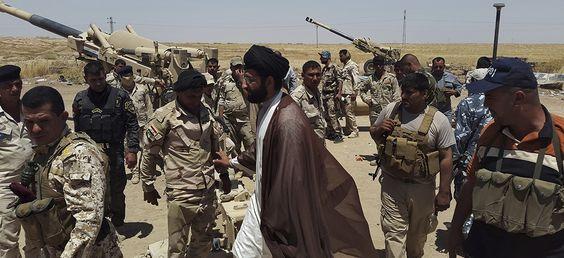 Des membres des forces de sécurité irakiennes, le 16 juin 2014. REUTERS/Stringer.