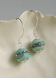 Artwork - Copper earrings by artist newmoon - Flame~worked glass, fine silver sparkles around an etched bead