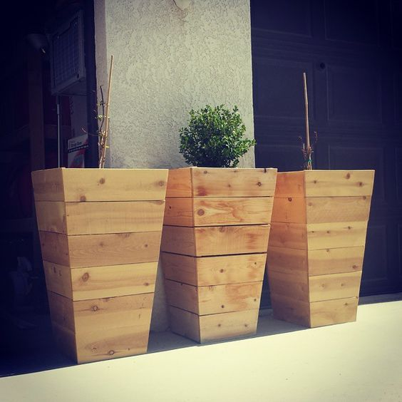 Gardens cedar planters and planters on pinterest for Tapered planter box plans