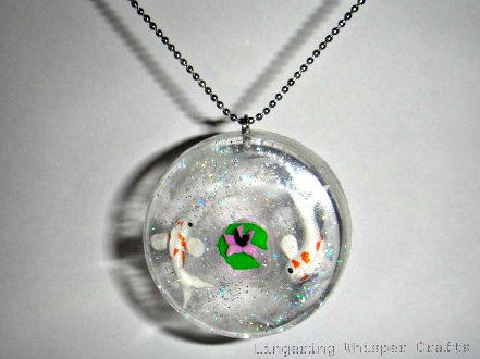 www.Lingeringwhispercrafts.co.uk    Handmade resin/clay koi necklace