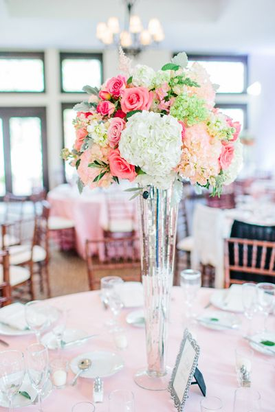 Another example of the centerpieces, minus the roses. They are also going to be sitting on square mirrors with little tea lights surrounding them.