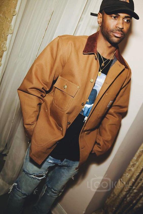 Big Sean wearing  Carhartt Duck Chore Coat, Fear of God 4th Collection Selvedge Denim Vintage Indigo Jean