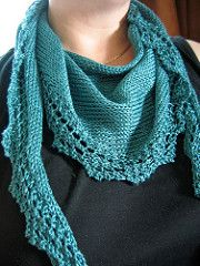 The scarf is a shallow triangle knitted from end to end. The i-cord edge and lace border are both knitted with the main body of the scarf.