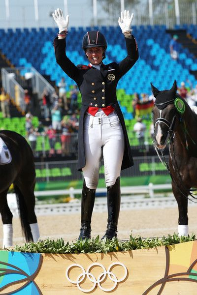 Gold medalist, Charlotte Dujardin of Great Britain riding Valegro celebrates on the podium during the medal ceremony during the Dressage Individual Grand Prix Freestyle on Day 10 of the Rio 2016 Olympic Games at Olympic Equestrian Centre on August 15, 2016 in Rio de Janeiro, Brazil.