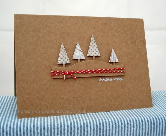 handmade Christmas card from I Dream in Paper: Muse Challenge #34 ... clean and simple ... kraft ... die cut landscape line with triangle trees colored in white ... luv it!!