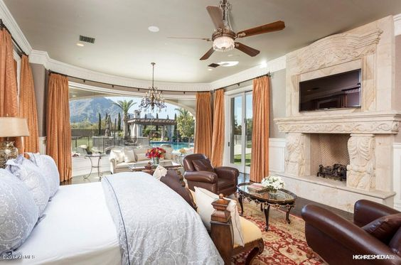 Master Suite with wide-open view through butted glass windows...
