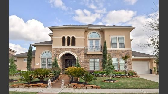 Stunning Stone and Stucco home with a great scenic view of the golf course.
