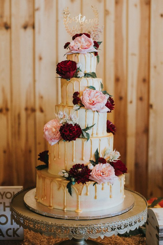 | drip wedding cake | gold wedding cake | maroon + gold wedding cake | maroon, blush + gold wedding cake | elegant wedding cake ideas | tall, five-layer, round wedding cake | unique wedding cake ideas | fall wedding cake | photo taken at THE SPRINGS Event Venue. follow this pin to our website for more information, or to book your free tour! SPRINGS location: Edmond, OK photographer: Rosie Cheeks Photography #weddingcake #fallwedding #weddingideas #weddingcolors #weddinginspiration #weddingday