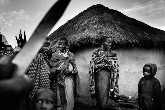 Meeri Koutaniem. Blood, Fear and Ritual: Witness to Female Circumcision in Kenya. Women of the village peel potatoes for the ritual dinner