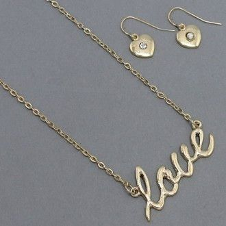"This little necklace spells out, as the immortal Mr. Lennon sang, all you need. ""Love"" is written in goldtone cursive and suspended at either side by delicate chains. Whether it's read as a positive message, an edict for life or simply a fashion statement for the day, this is a beautiful necklace that you'll want to wear constantly. Matching rhinestone-kissed heart earrings come with a french hook backing."