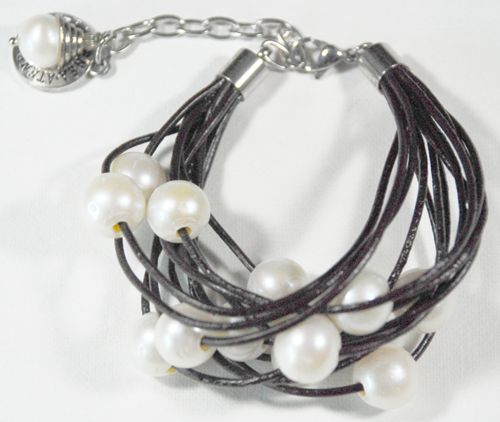 Bracelet with large white freshwater pearls floating on coffee brown l