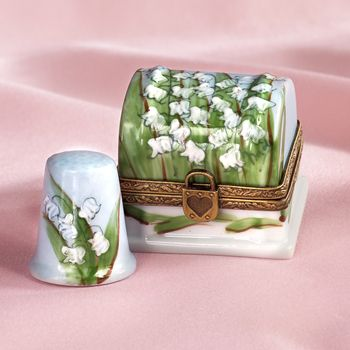 French handpainted Lilly of the valley thimble box with thimble.