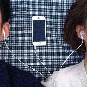 Couple sharing earphones