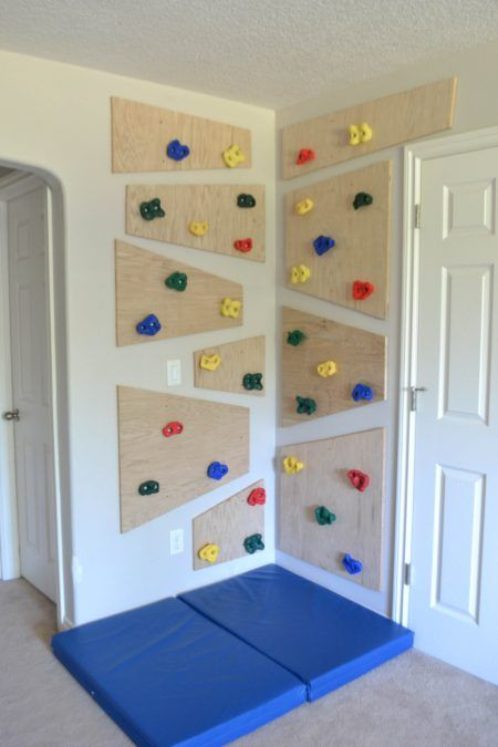 Kids climb walls. So why not give them one they are allowed to climb? Here is how to build an awesome diy indoor climbing wall. #diy_kids_wall