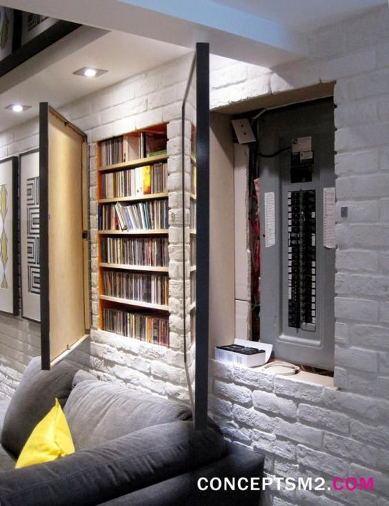 If you're obsessed with the idea of hidden rooms, you'll probably get a kick of out this idea of creating hidden storage in your walls.