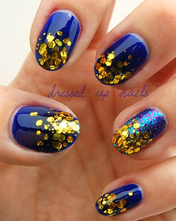 Dark blue (and blue glitter) with gold hexagon glitter tips...elegant yet bold at the same time!
