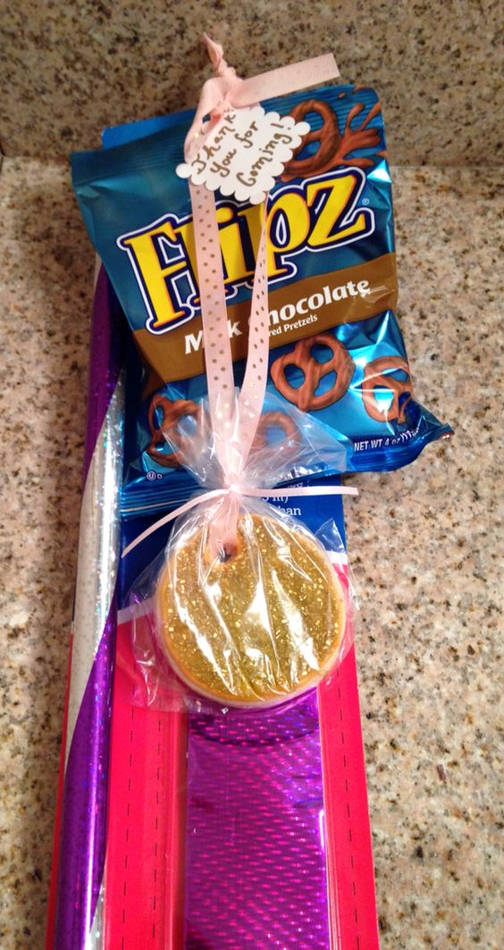 The favors for Elise pink and gold gymnastics party! I made sugar cookie gold medals!